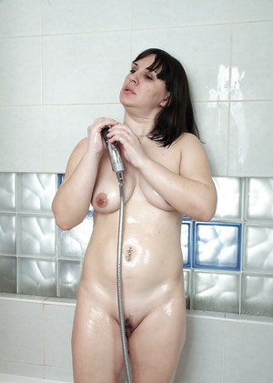 Older woman Belta showing off exposed labia lips in the shower