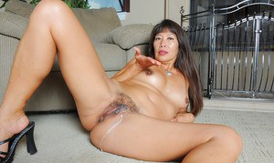 Older Asian woman Sakura Lei getting undressed for cunt licking