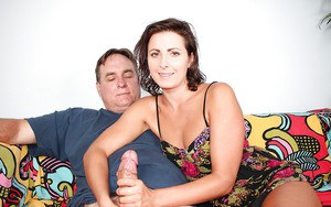 Barefoot and clothed mature woman giving a handjob to husband