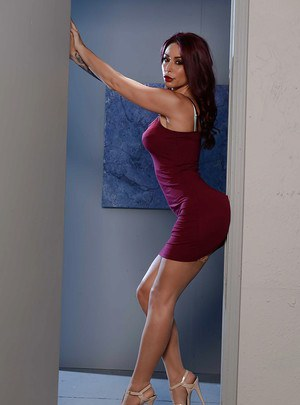Leggy tattooed pornstar Monique Alexander striking hot fully clothed poses