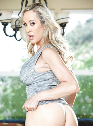 Blonde MILF Brandi Love posing fully clothed before stripping naked