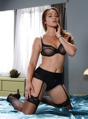 Handcuffed housewife Dani Daniels appears in sexy stockings and lingerie