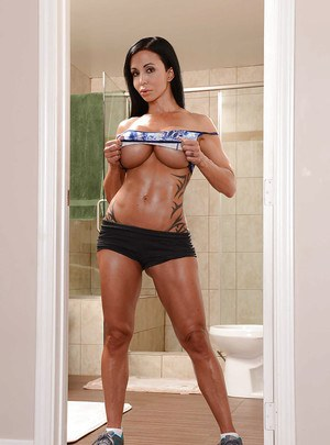 Buxom MILF Jewels Jade posing in sports bra and spandex shorts