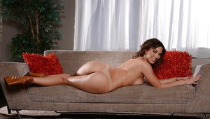 Glasses clad wife Lily Love spreading legs on couch and flashing panties