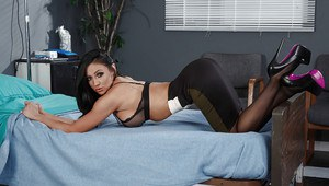 Curvy brunette babe Audrey Bitoni undressing to pose in hose and heels