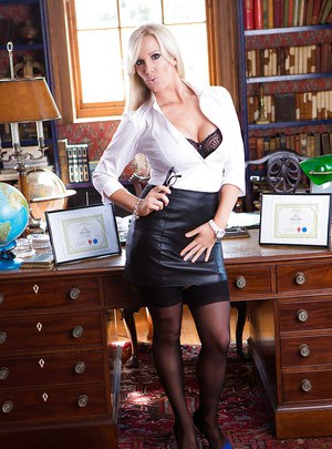 Hot mature teacher Rebecca Moore striking sexy poses in leather skirt