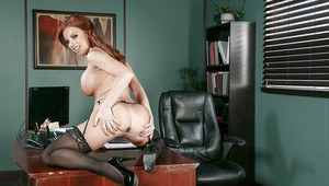 Busty office worker Britney Amber parts pink pussy for close ups