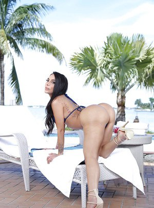 Big boobed Latina babe Lela Star showing off delicious big booty outdoors