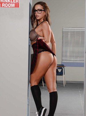 Schoolgirl Abigail Mac spreading legs in knee high socks and glasses