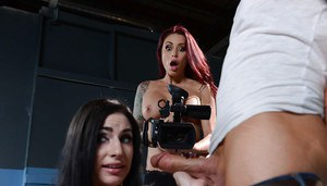 Tattooed pornstar Monique Alexander and girlfriend suck off huge dick