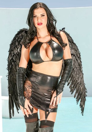 Sultry brunette MILF Jasmine Jae posing in leather Angel outfit and boots