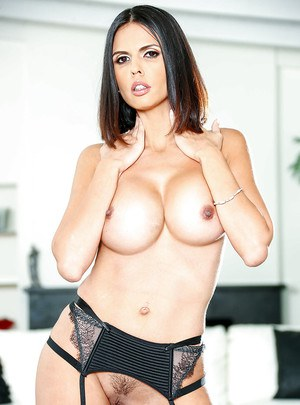 Leggy and busty Latina Shay Love posing topless in nylons and heels