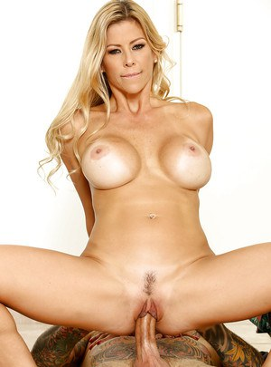 Chesty blonde mom Alexis Fawx giving large cock a blowjob on knees