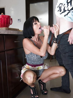 Buxom cougar Veronica Avluv stroking a young stud's massive penis