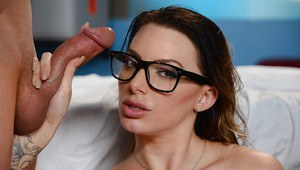 Glasses clad doctor Juelz Ventura sucking off patient's long cock