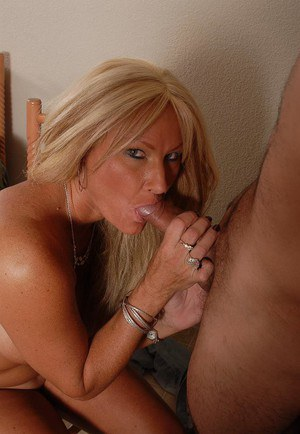 Mature blonde lady Roxy has shaved cunt licked out and gives bj in return