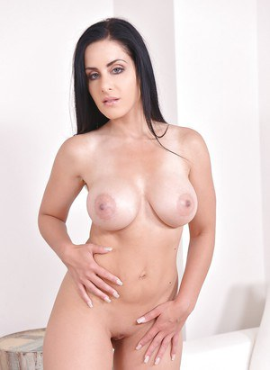 Gorgeous busty beauty Alex Black playing with her shaved pussy