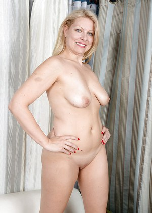 Beautiful blonde MILF Zoey Tyler playing with her beautiful bald cunt