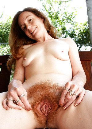 Kinky redhead MILF Ana Molly playing with her wet hairy pussy outdoors