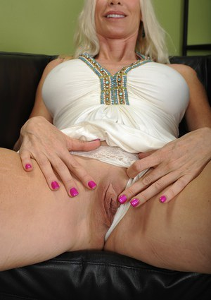 Busty blonde mature Cameo showing off her incredible big boobs