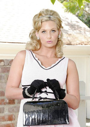 Blonde lady Phoenix Marie posing outdoors in retro dress and black gloves