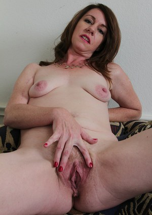 Older mom Joanie Bishop stripping naked and tugging on nipples