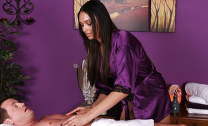 Ebony beauty Bethany Benz jerking off a cock at the local massage parlour