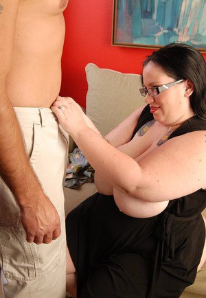 Glasses clad BBW Glory-Foxxx on knees to suck cock and give titjob