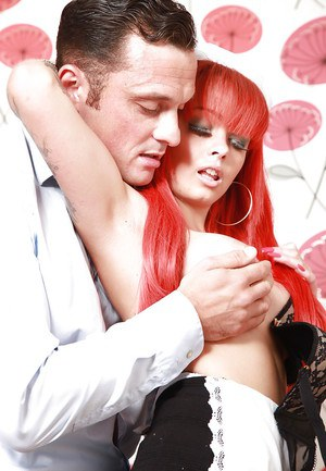 Busty redheaded maid Billie Rai plays with big tits while having sex