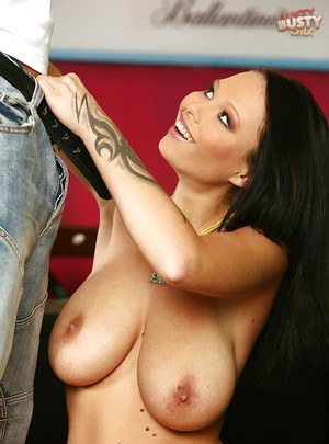 Busty brunette babe Domino flashing shaved cunt while giving blowjob