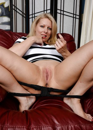 Experienced blonde dame Zoey Tyler pulls down panties to expose bald twat
