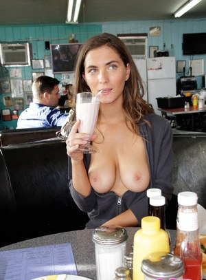 First timer Roxanne exposing her large natural breasts in public house