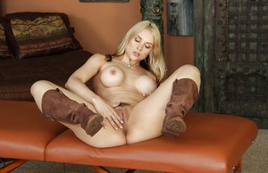 Blonde MILF Sara Vandella poses solo in boots and thong underwear