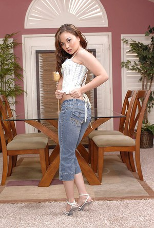 Young Asian cutie Kita Zen posing for non nude pics in denim jeans