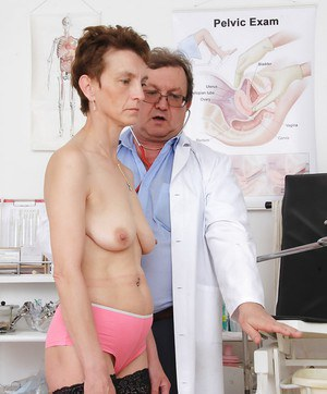 Skinny granny Rozi has her pussy stretched for vulva and clitoris exposure