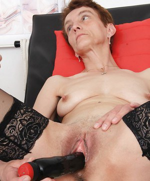 Mature redhead Rozi stripping naked for medical examination