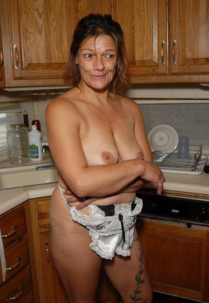 Experienced blonde lady Ivee showing off thong adorned butt in kitchen