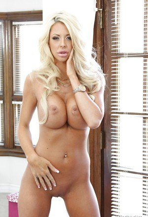 Buxom blond MILF Courtney Taylor hitting sexy solo girl poses in high heels