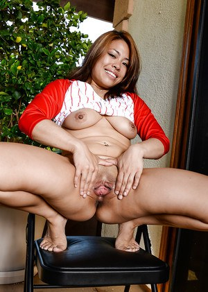 Asian spinner Laci Hurst pulling down her pants to show off smooth pussy