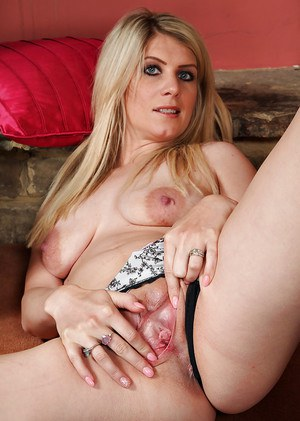 Euro MILF Ashleigh McKenzie strips off denim jeans to play with bald pussy