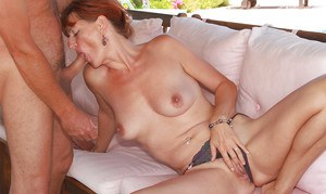 Older redhead Liddy fingers her mature pussy outdoors while giving blowjob
