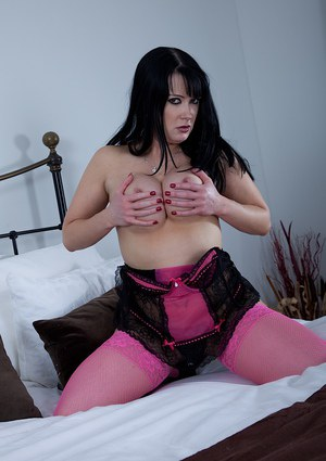 Busty Euro lady Tanya Cox posing topless in pink nylons and high heels