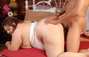 Obese model Reyna goes for the topless look while jerking cock