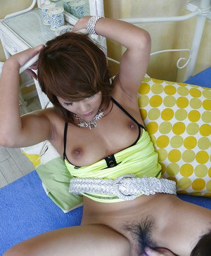 Japanese chick Akiho Nishimura having her hairy pussy toyed by man