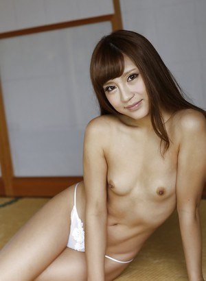 Tiny Asian chick Anna Anjo stripping naked to bare small breasts