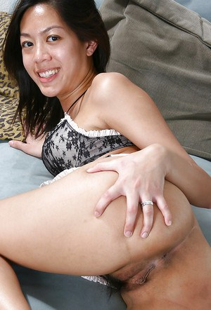 Young Asian first timer Starlingz baring small tits and hairy bush