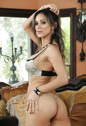 Slender Latina brunette Nadia Styles letting big breasts loose from blouse