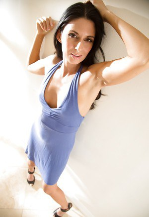 Leggy brunette MILF Niki Daniels posing fully clothed in dress and heels