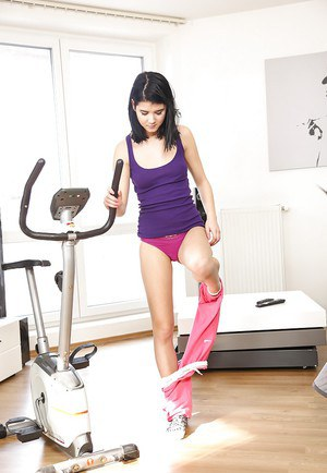 Petite coed Lady D working out on exercise bike in purple panties