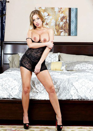 Blonde beauty Britney Amber striking sexy lingerie solo poses in bedroom